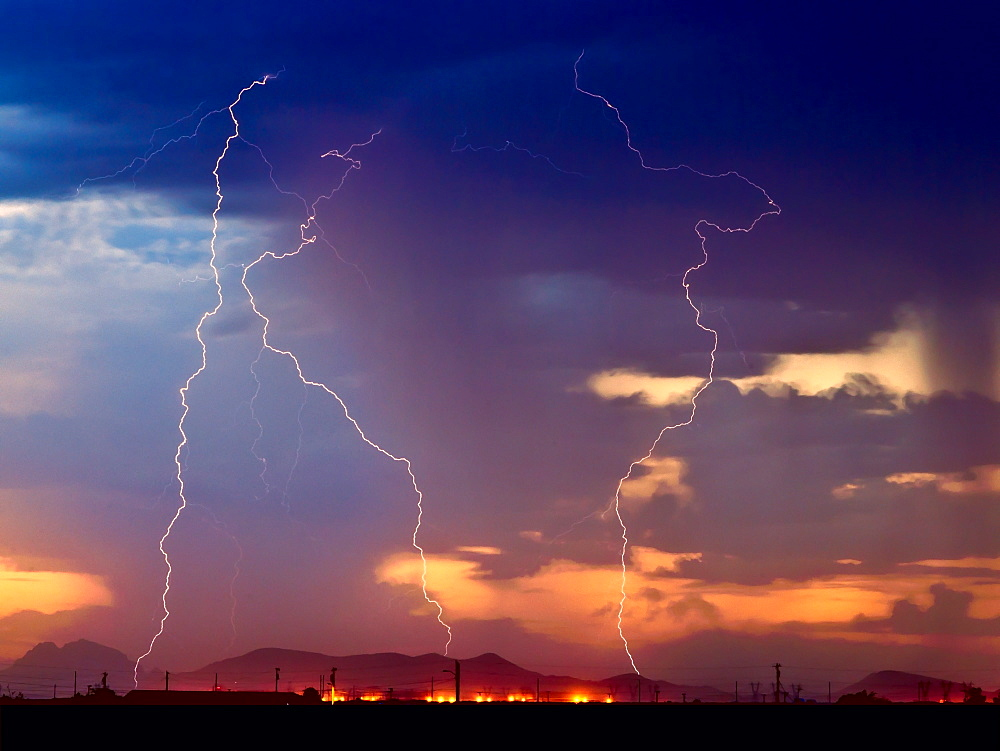 Three bolts of lightning striking near the Palo Verde Nuclear Station in Wintersburg Arizona during the 2012 Monsoon season, Arizona, United States of America, North America