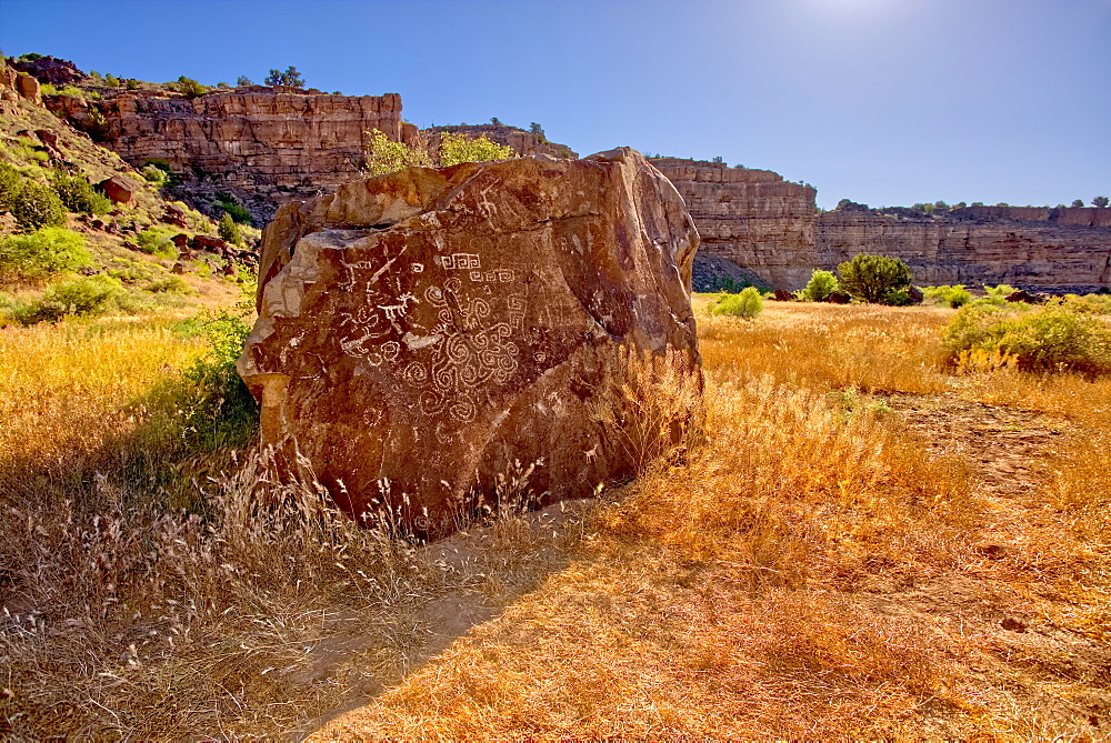 A large petroglyph covered boulder in dry Stillman Lake at the bottom of the Verde River Canyon in Paulden, Arizona, United States of America, North America