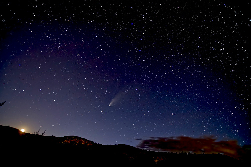 Comet NeoWise 2020 above Sullivan Butte in Chino Valley Arizona. Moon on the lower left. The Big Dipper is in the center.