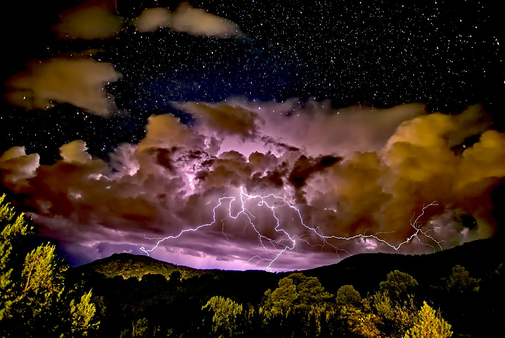 A storm approaching Sullivan Butte in Chino Valley at night with a starry sky above, Arizona, United States of America, North America - 1311-244