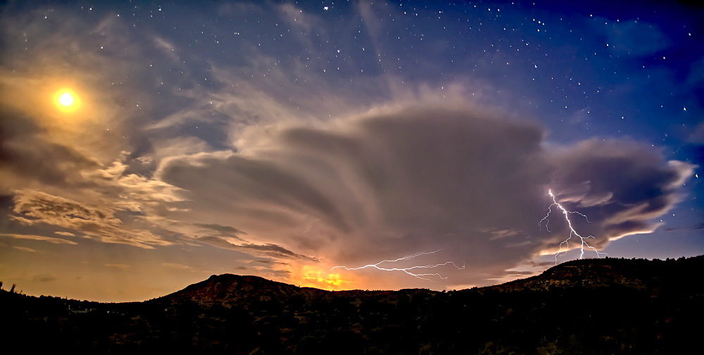 An isolated storm cell near Chino Valley being lit by the Moonlight during the summer monsoon season, Arizona, United States of America, North America - 1311-246