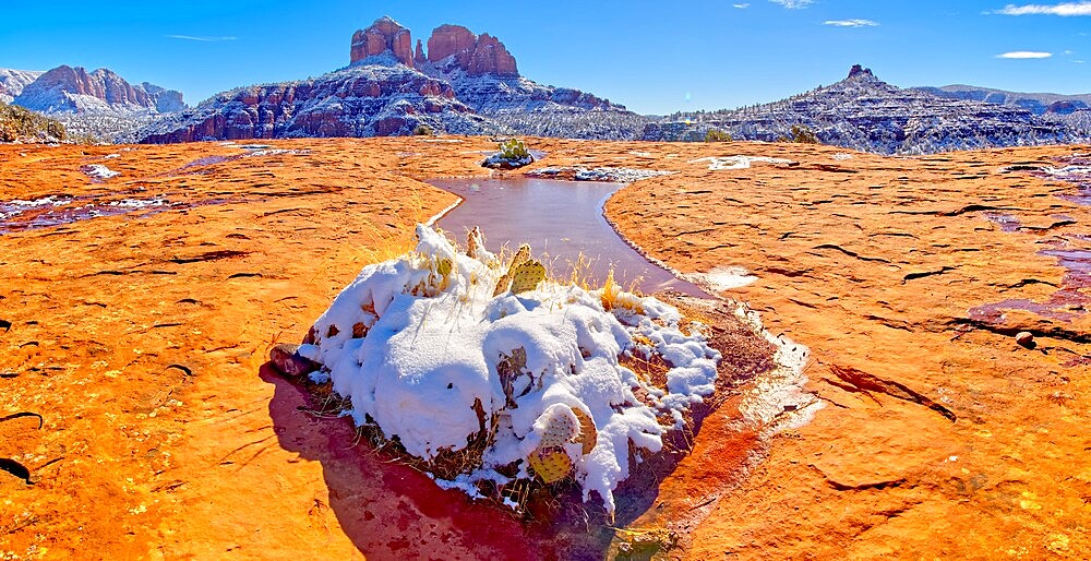 Snow covered Cathedral Rock in Sedona viewed from a sandstone plateau along Secret Slick Rock Trail, Arizona, United States of America, North America - 1311-278