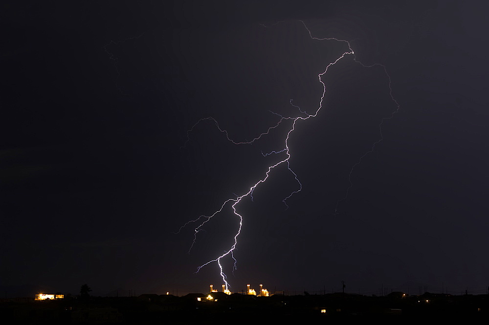 Lightning striking a powerplant in Arlington Arizona during the 2016 Monsoon season.