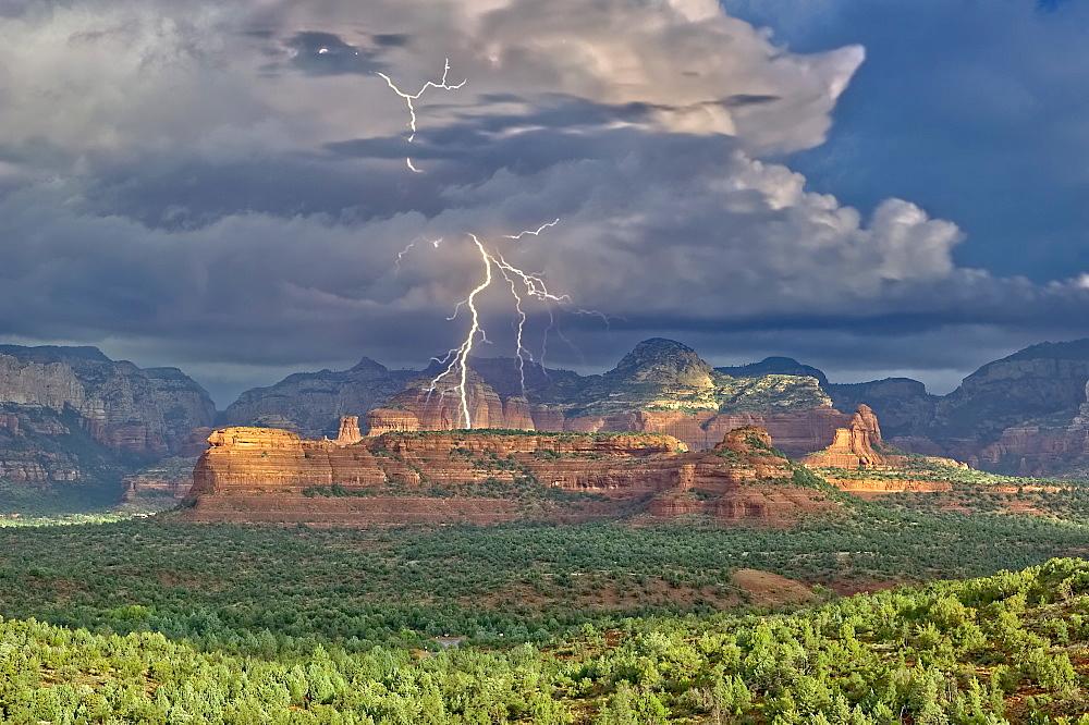 Red Rock Wilderness Lightning, a morning lightning storm over the Secret Red Rock Mountain Wilderness in Sedona, Arizona, United States of America, North America
