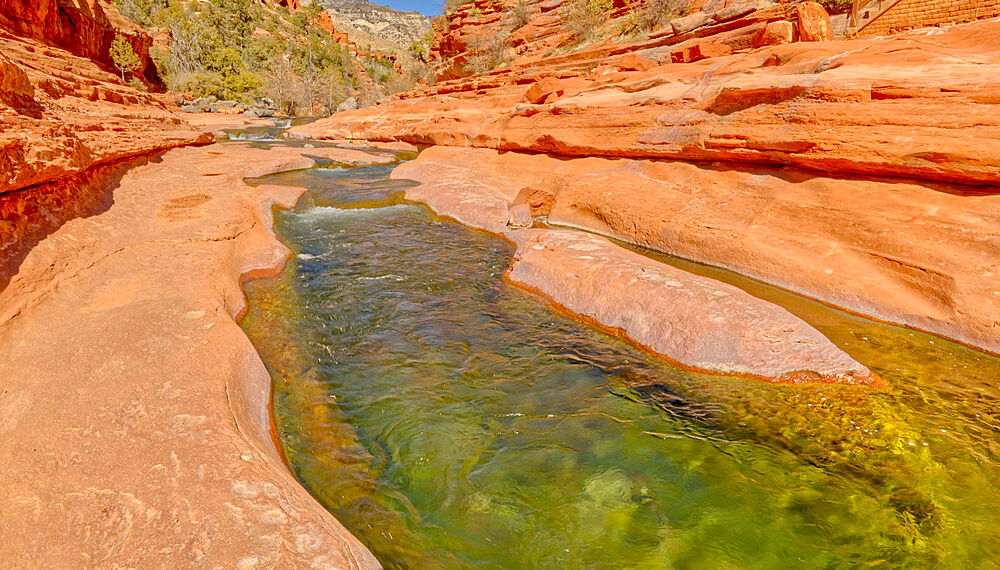 Slick rock water channel in Slide Rock State Park where most swimmers begin their slide in Oak Creek north of Sedona Arizona. - 1311-319