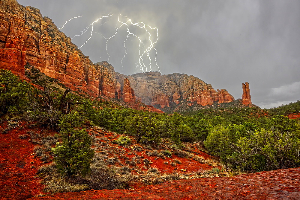 A lightning storm moving in across Lee Mountain just northeast of the Rabbit Ears formation in Sedona, Arizona, United States of America, North America