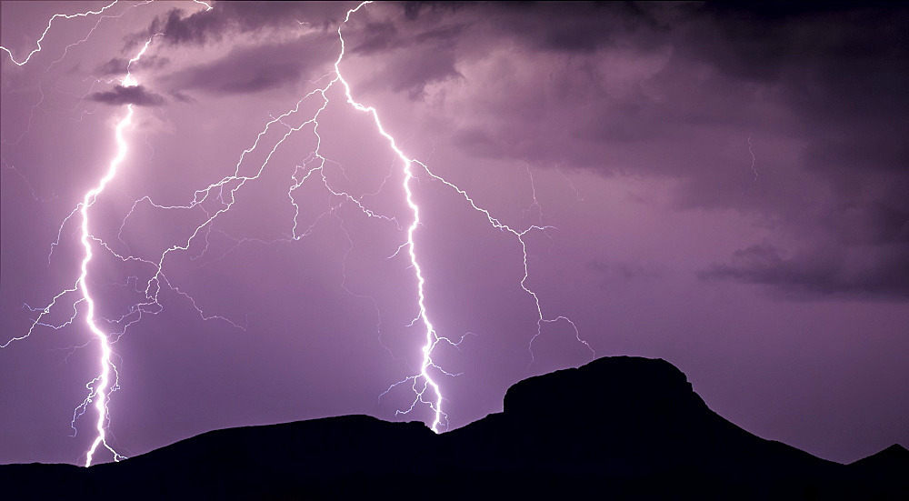A panorama photo of lightning striking the slopes of Woolsey Peak during the 2012 Arizona Monsoon season, Arizona, United States of America, North America