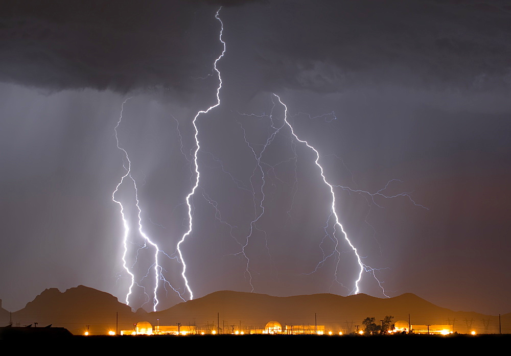 A large lightning storm behind a nuclear power plant in western Arizona during the 2014 Monsoon season.
