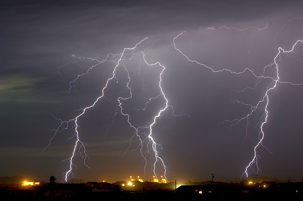 Multiple lightning bolts striking a power plant in Arlington during the 2016 monsoon season, Arizona, United States of America, North America
