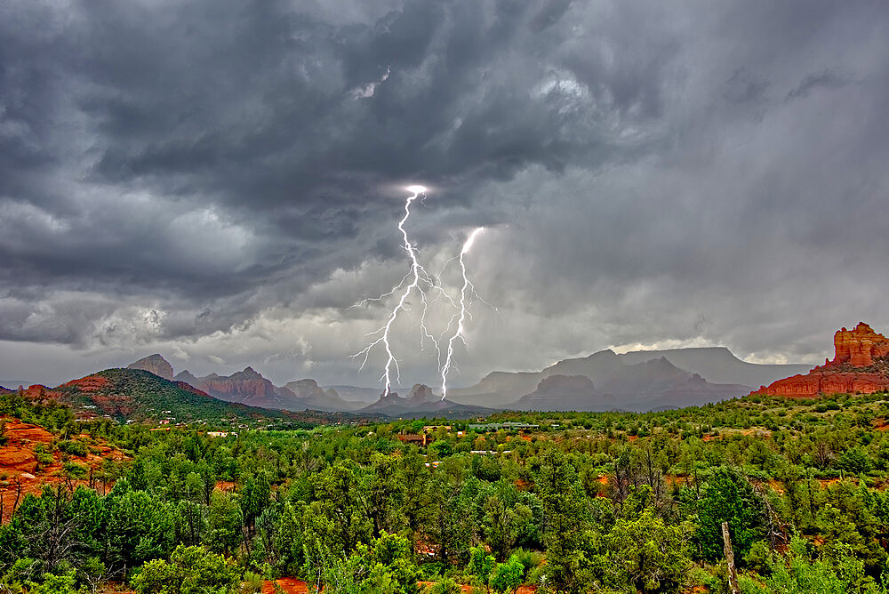 Lightning striking during a storm over Cibola Rock in Uptown Sedona Arizona. Viewed from the Broken Arrow Trail. - 1311-99