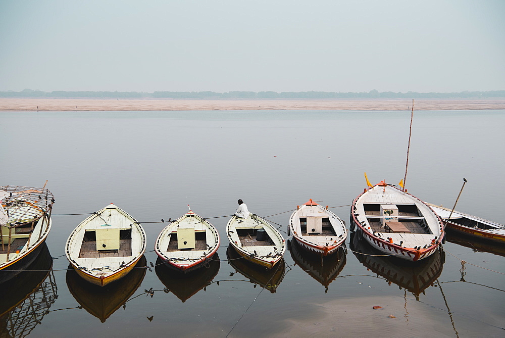 Moored boats line the ghats of the Ganges, Varanasi, Uttar Pradesh, India, Asia