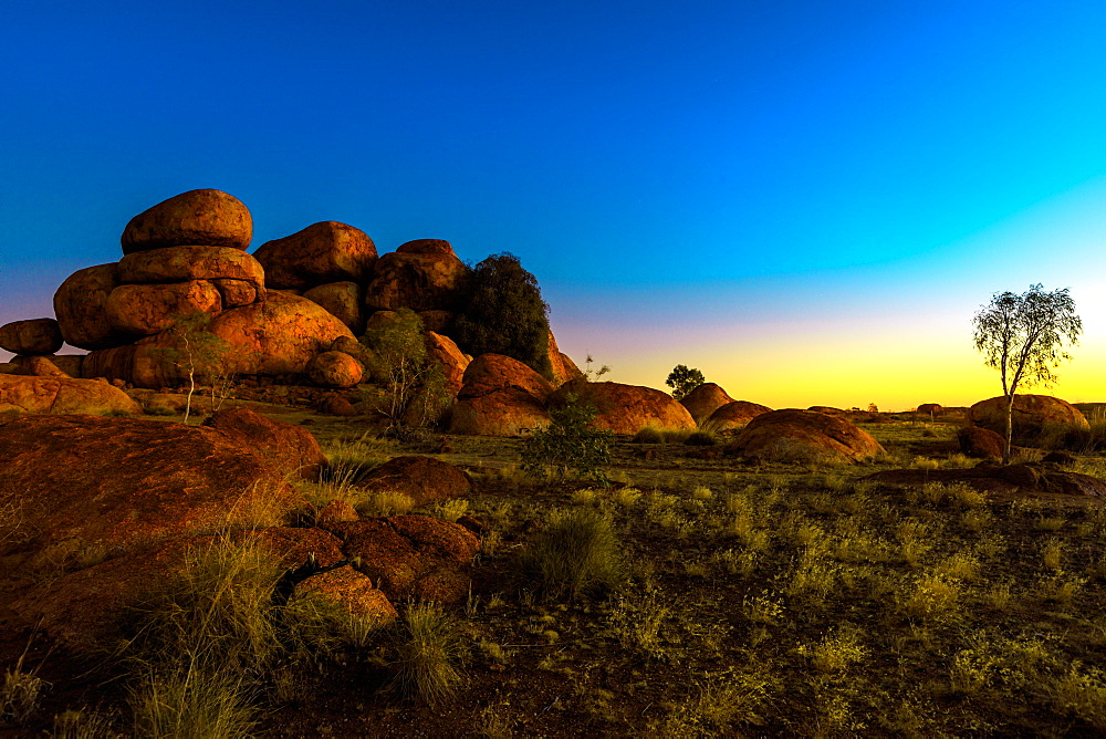 Outback landscape of Devils Marbles rock formations after twilight, granite boulders of Karlu Karlu (Devils Marbles) Conservation Reserve at dusk in Northern Territory, Australia, Pacific