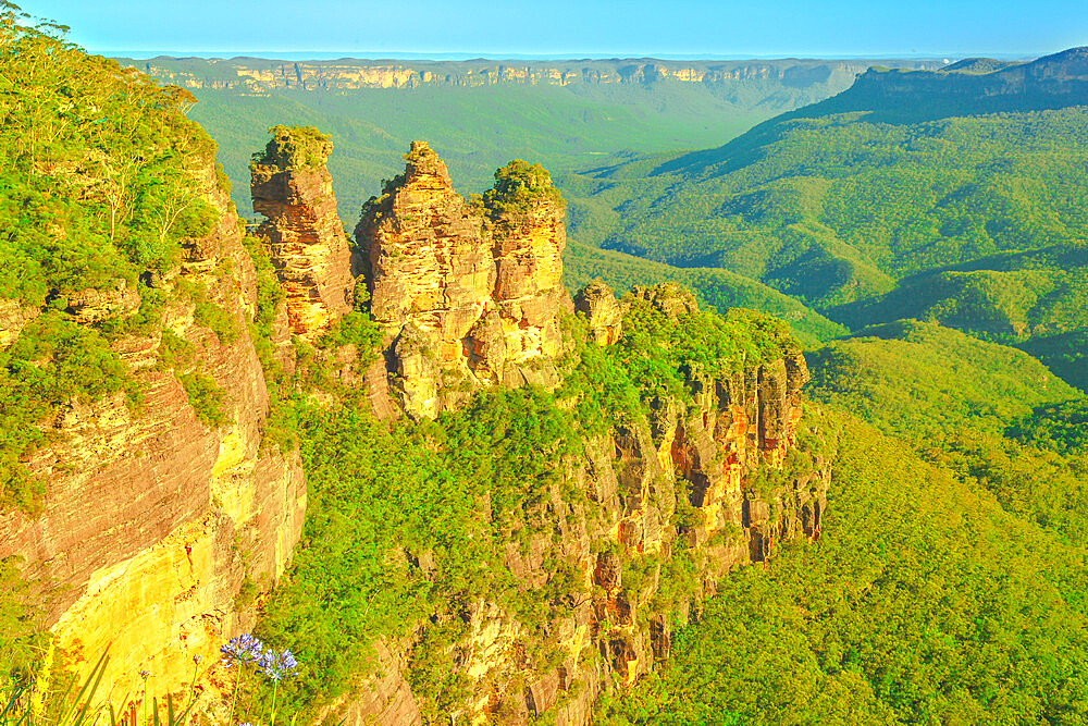 Three Sisters in Blue Mountains Range, Katoomba, New South Wales, Australia. Aerial view of famous landmark sandstone cliffs rock formation, one of the best-known attractions in National Park.