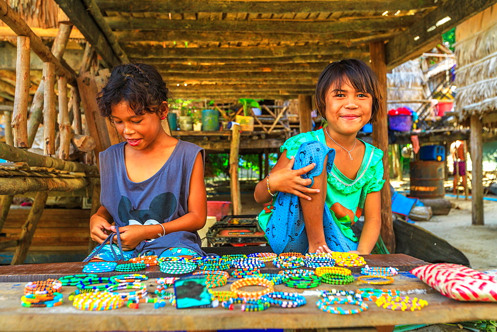 Surin Islands, Phang-Nga, Thailand - January 3, 2016: Sea Gypsies little girls selling necklaces and bracelets in Moken tribe, fisherman village of Ko Surin Marine National Park.