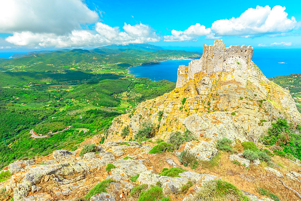 Iconic view of Volterraio Castle on rock at 394 m. Fortress of Volterraio, symbol of Elba Island, dominates Portoferraio Gulf. Panoramic landscape with view from top of Elba mountain. Tuscany, Italy. - 1314-226