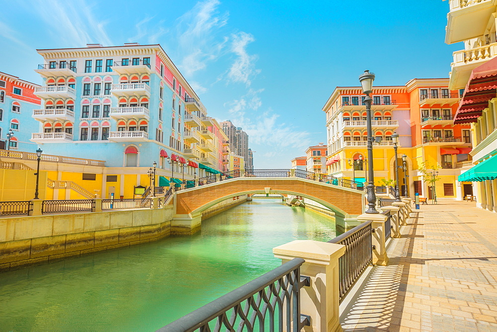 Beautiful Little Venice with canals connected by bridges in Venetian style and colourful houses in picturesque Qanat Quartier, Venice at the Pearl, Doha, Qatar, Middle East