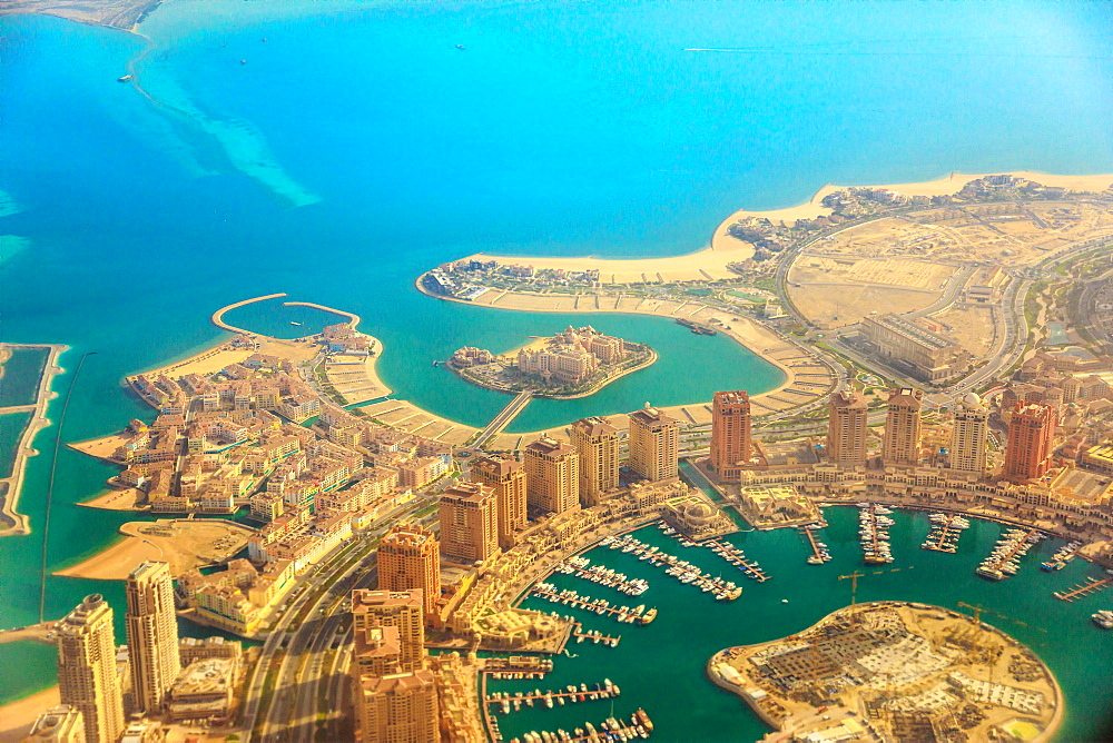 Aerial view of the Pearl-Qatar, the luxurious modern artificial island in the Persian Gulf, Venice at Qanat Quartier, Marsa Malaz Kempinski hotel and towers of Porto Arabia, Doha, Qatar, Middle East.