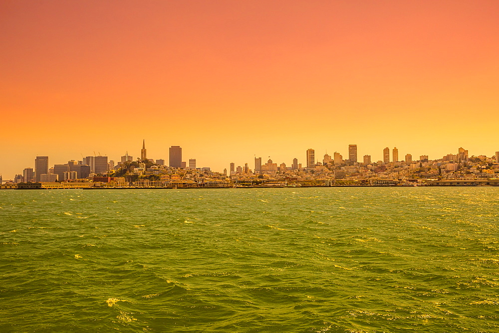 Sea view from boat to Alcatraz at sunset of San Francisco Financial District skyline, San Francisco, California, United States of America, North America