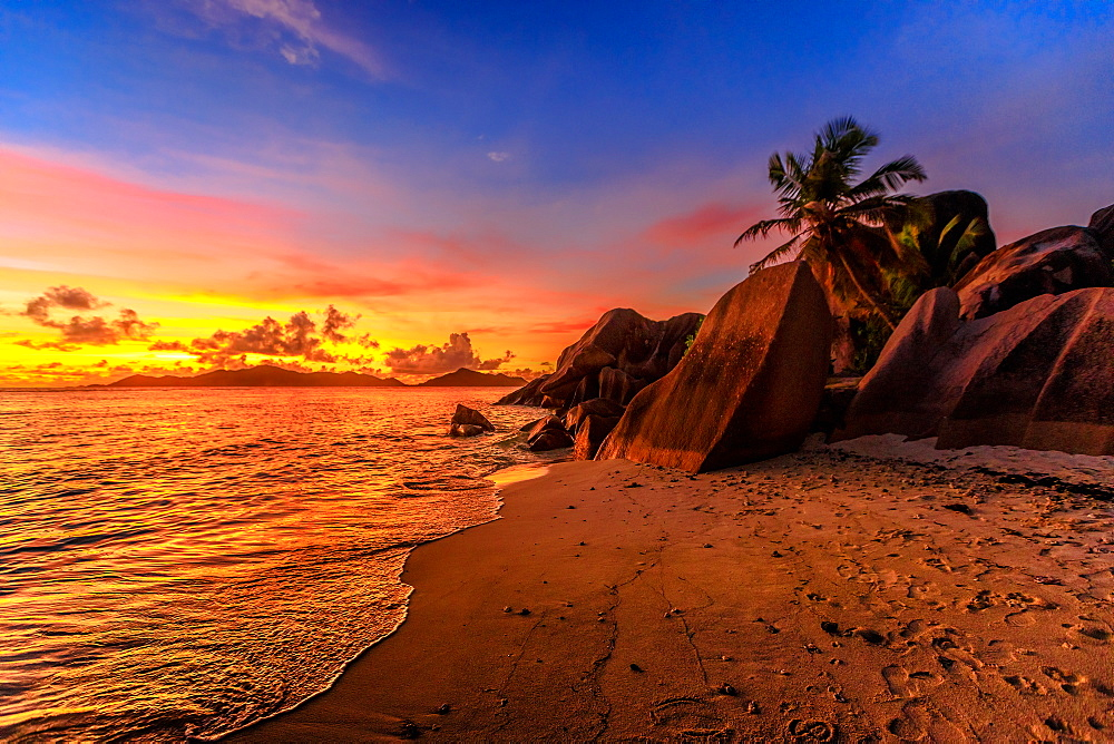 Anse Source d'Argent Beach at sunset in Seychelles, La Digue. Amazing landscape with colorful sky above rock granite stone.