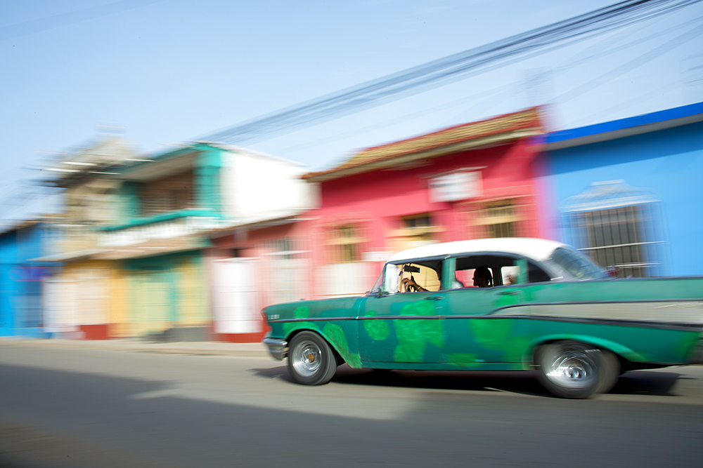 Old car blurring by on the streets of Trinidad, Cuba, West Indies, Caribbean, Central America - 1315-101