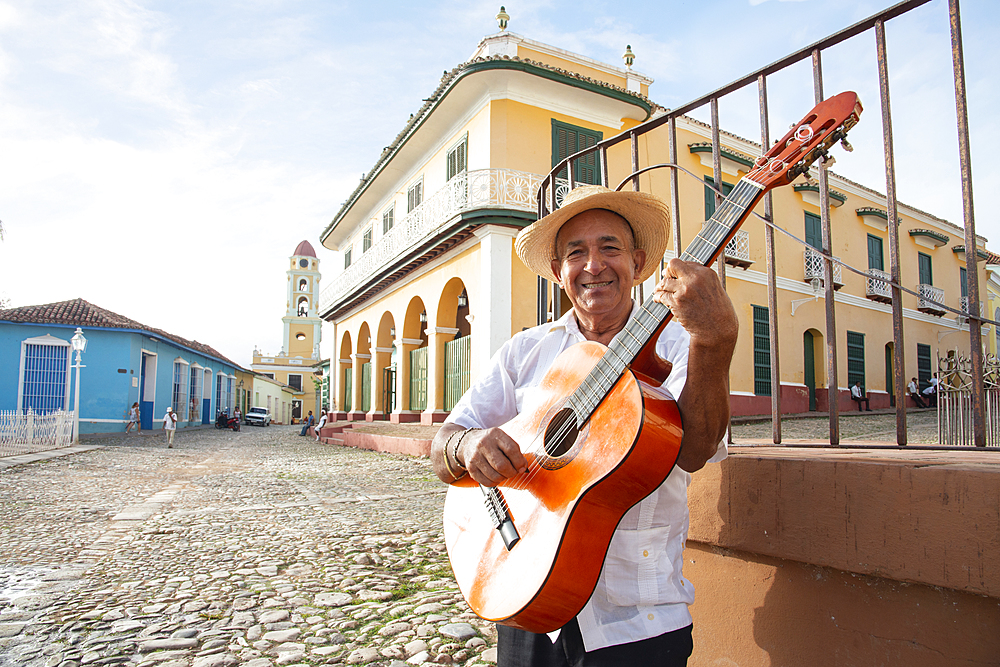 Local man singing and playing his guitar in the Plaza Mayor of Trinidad, UNESCO World Heritage Site, Cuba, West Indies, Caribbean, Central America - 1315-103