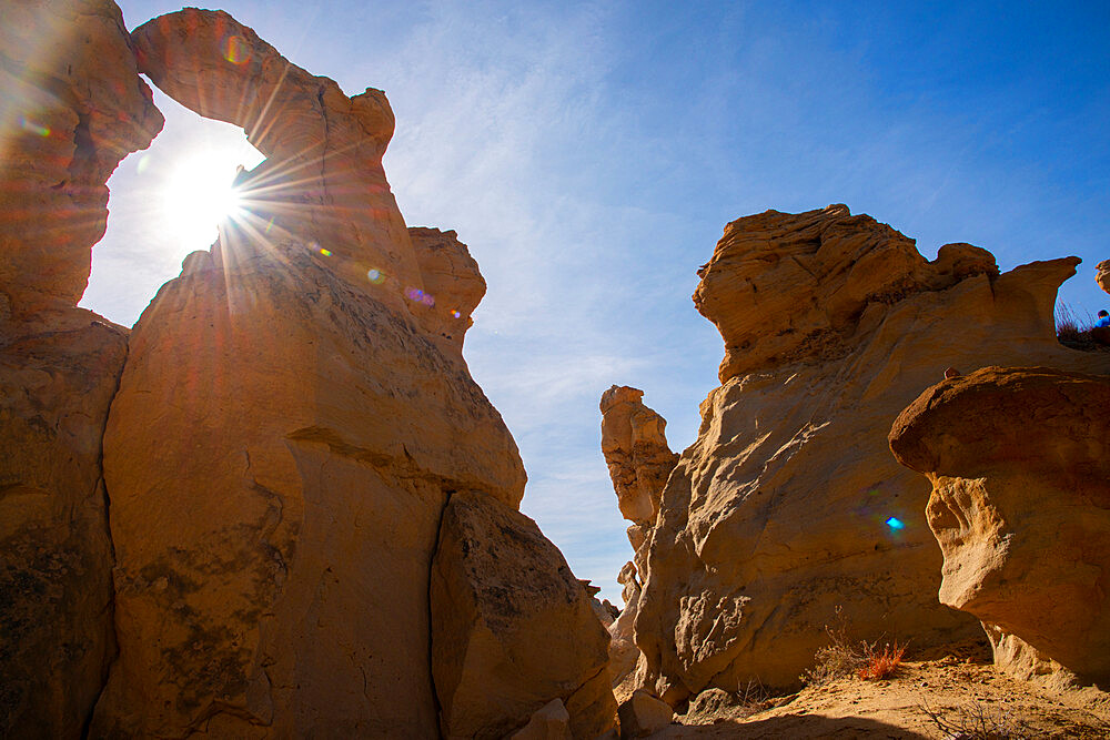 Sandstone sculptures in Bisti/De-Na-Zin Wilderness in New Mexico. Intentional sun flare