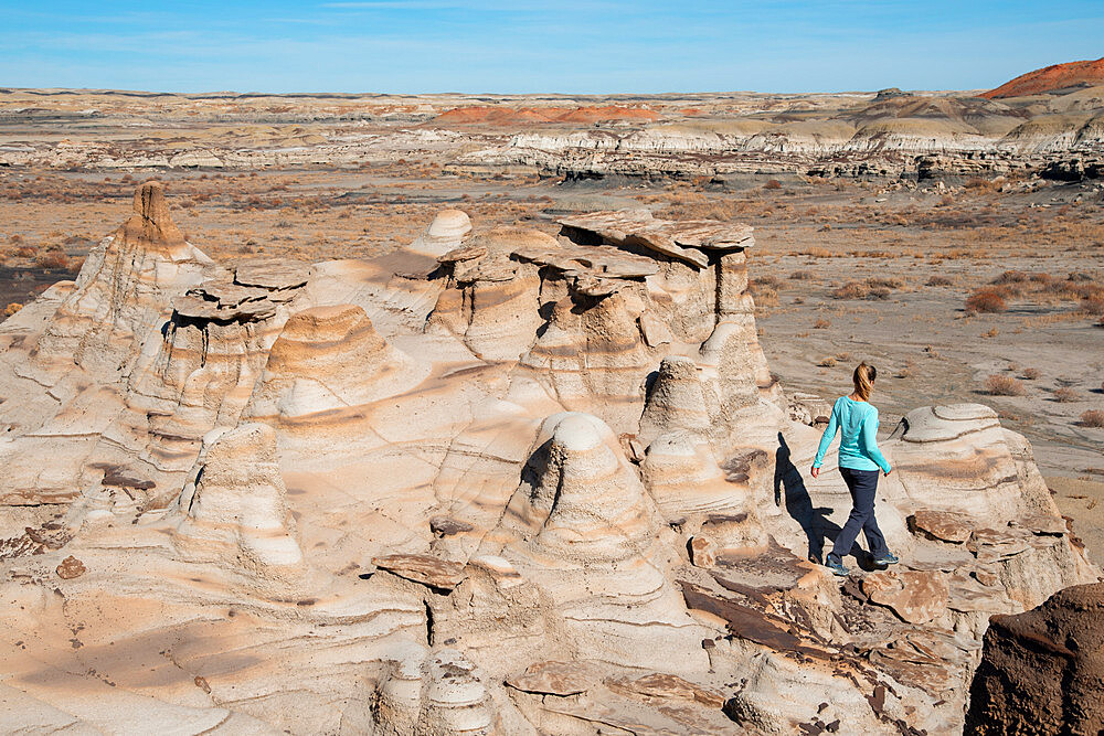 Hiking around hoodoo sandstone formations in Bisti/De-Na-Zin Wilderness, New Mexico. - 1315-156