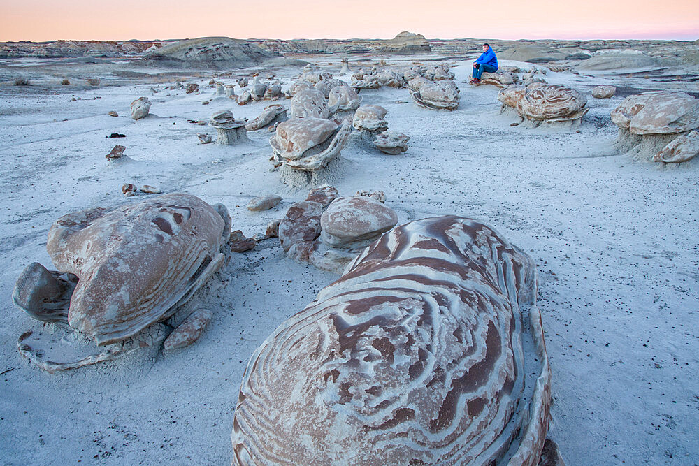 Exploring the 'cracked egg' sandstone formations of Bisti/De-Na-Zin Wilderness in New Mexico at sunset. .