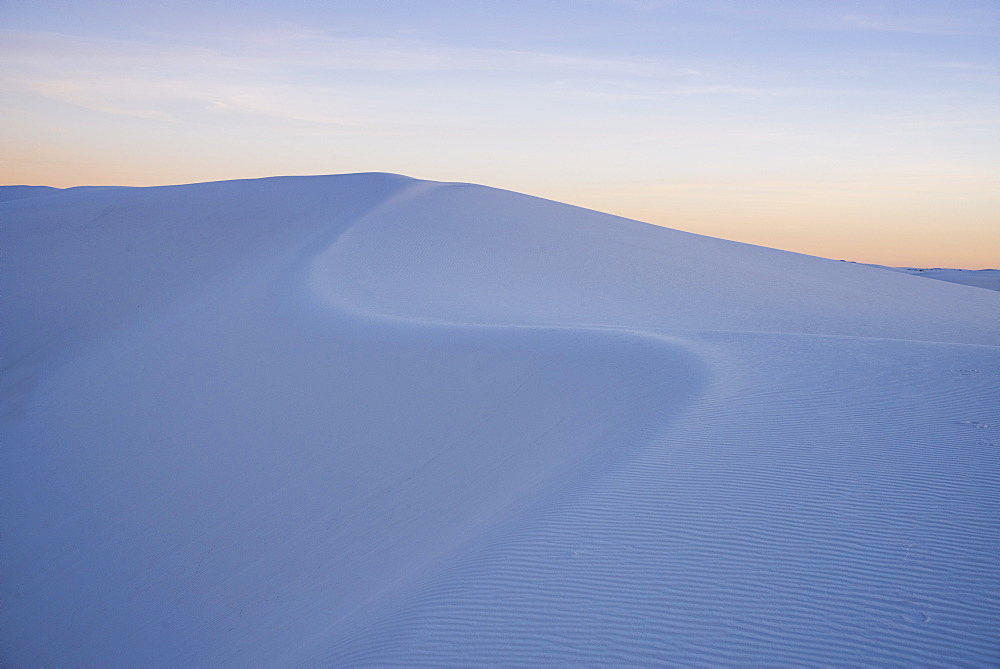 The curve of a sand dune at sunset in White Sands National Park, New Mexico, United States of America, North America