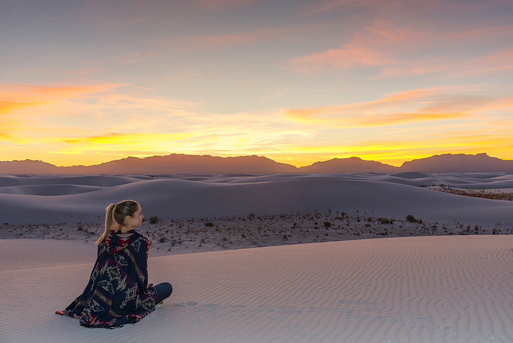 Woman watching the sunset in White Sands National Park, New Mexico, United States of America, North America