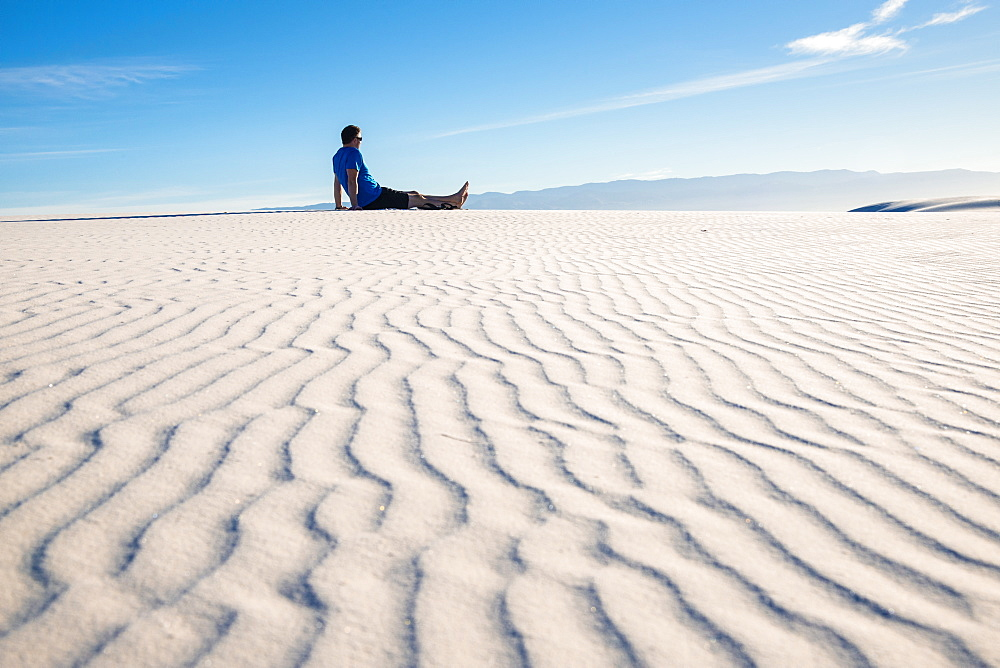 Man gazing out at the view in White Sands National Park, New Mexico