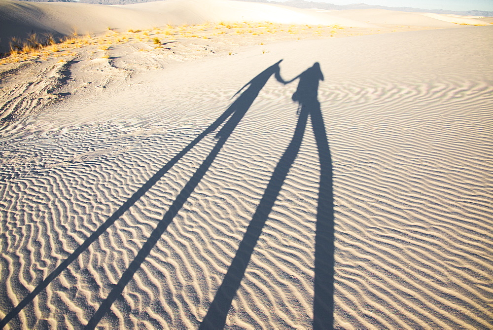 Two dorks playing with shadows in White Sands National Park, New Mexico, United States of America, North America
