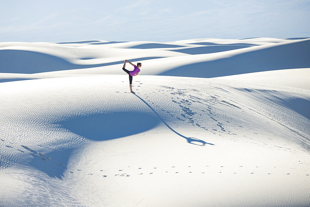 Stretching with a yoga pose in White Sands National Park, New Mexico, United States of America, North America