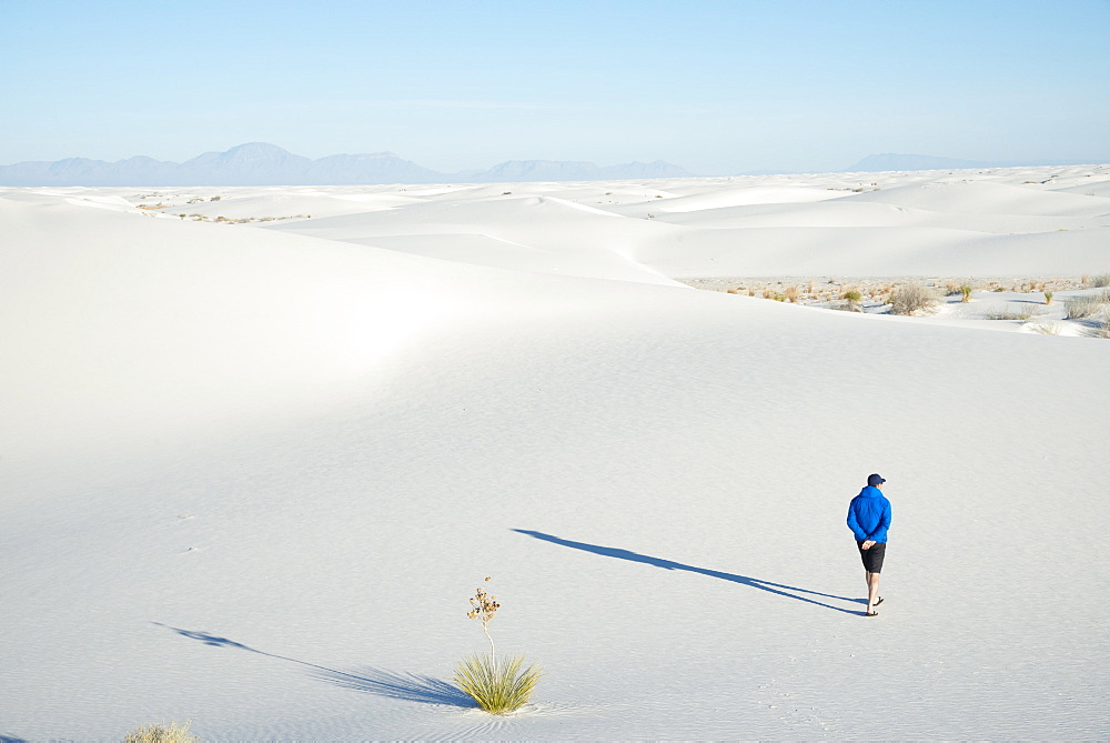 A man exploring the vast landscape of White Sands National Park, New Mexico