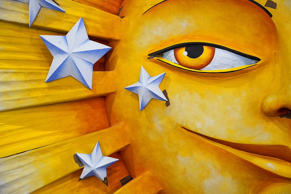 Detail of a giant sunshine made of styrofoam that will appear on a Mardis Gras float.