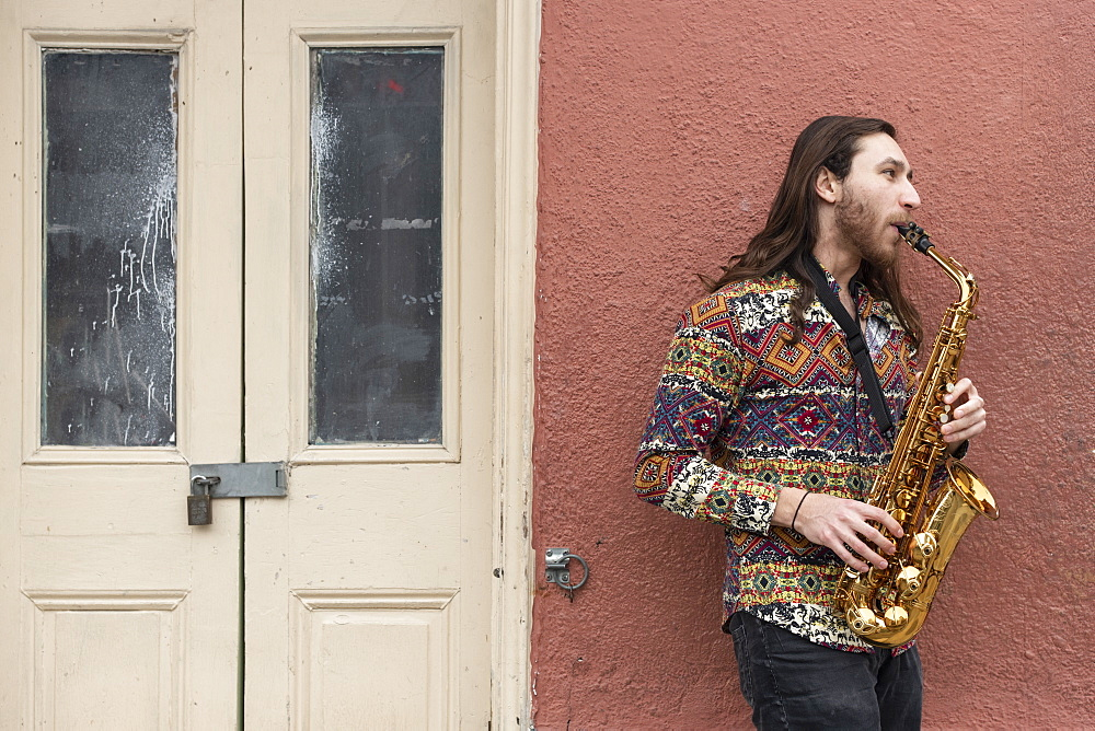 Saxophone player on a Bourbon Street corner in the French Quarter of New Orleans.