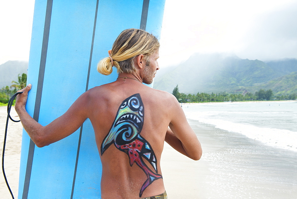 Surfer in Hanalei Bay, with a shark painted on his back, Kauai, Hawaii, United States of America, North America - 1315-263