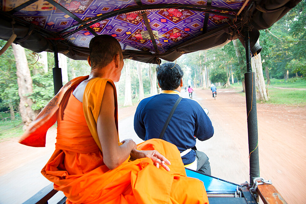 Buddhist monk riding in a tuktuk at the Angkor archaeological park in Siem Reap, Cambodia, Indochina, Southeast Asia, Asia - 1315-303