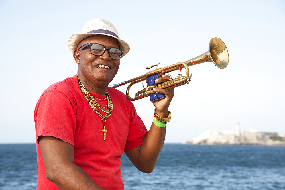 Trumpet player along the Malecon in Havana, Cuba, West Indies, Caribbean, Central America - 1315-67