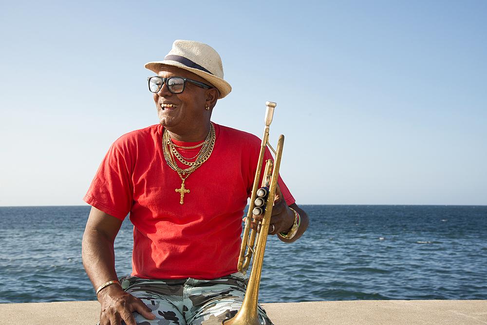 Trumpet player along the Malecon in Havana, Cuba. Model released.