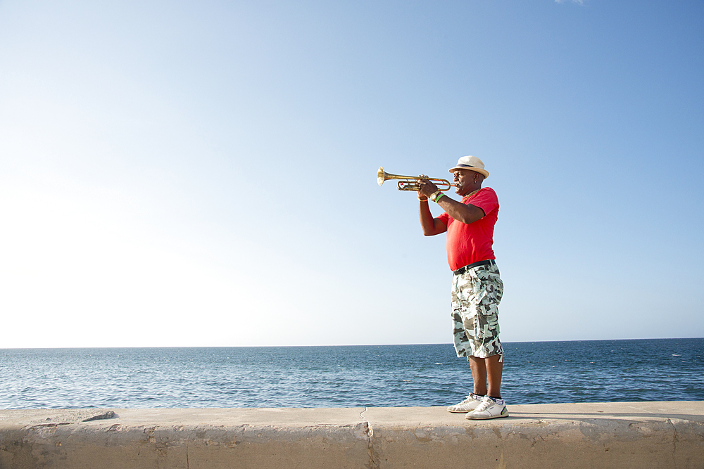 Trumpet player along the Malecon in Havana, Cuba, West Indies, Caribbean, Central America