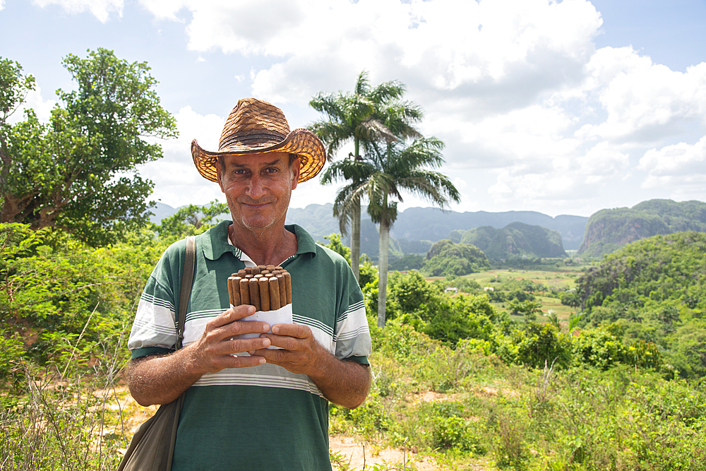Local man selling Cuban cigars in Vinales, UNESCO World Heritage Site, Cuba, West Indies, Caribbean, Central America - 1315-76