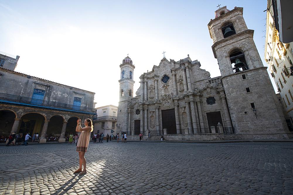 Tourist in Cathedral Square (Plaza de la Catedral) in Old Havana, Havana, Cuba. Model released