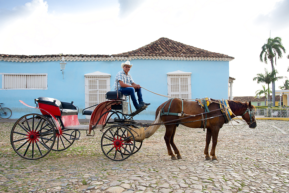 Cowboy waiting for riders with his horse and carriage in Plaza Mayor, Trinidad, UNESCO World Heritage Site, Cuba, West Indies, Caribbean, Central America - 1315-94
