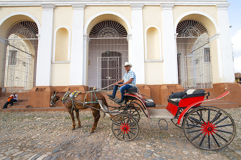 Horse and carriage in the Plaza Mayor and Church of the Holy Trinity, UNESCO World Heritage Site, Trinidad, Cuba, West Indies, Caribbean, Central America