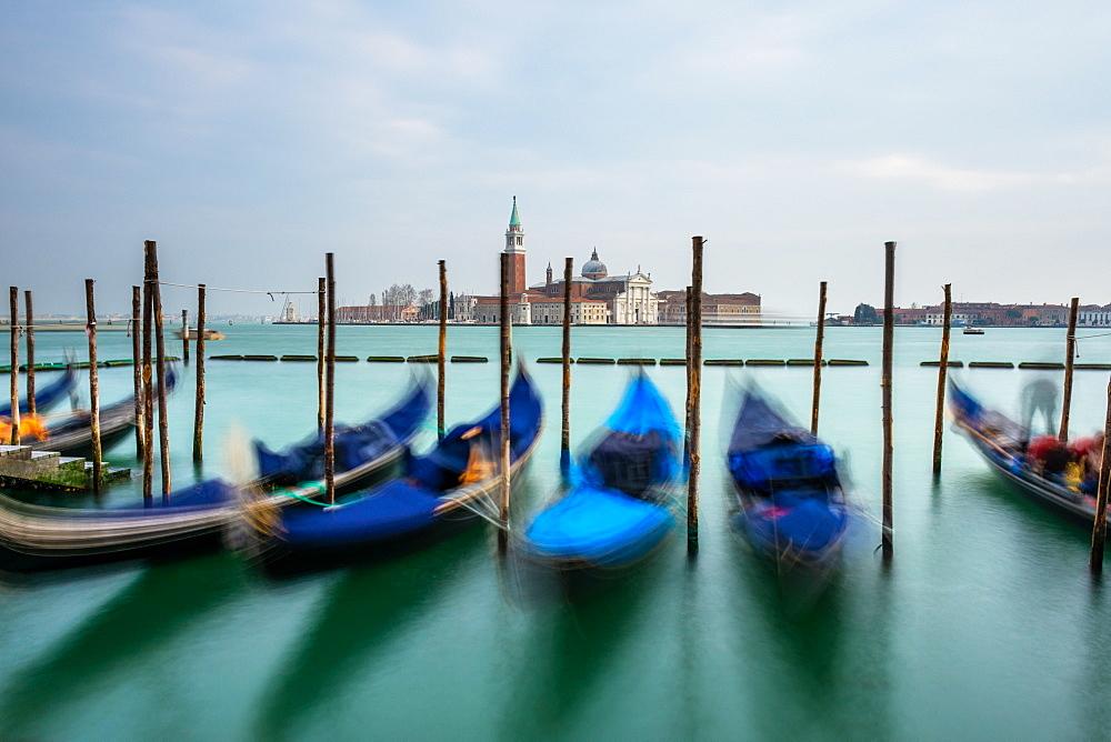 Gondolas moored in Piazza San Marco with San Giorgio Maggiore church in the background - 1316-1