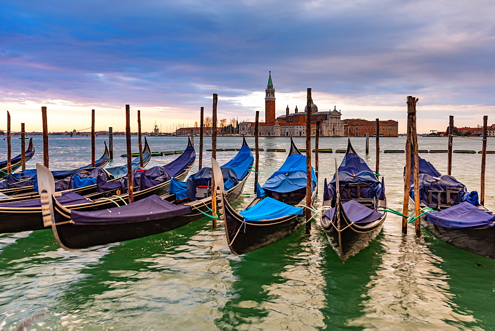 Gondolas moored in Piazza San Marco with San Giorgio Maggiore church in the background, Venice, UNESCO World Heritage Site, Veneto, Italy, Europe