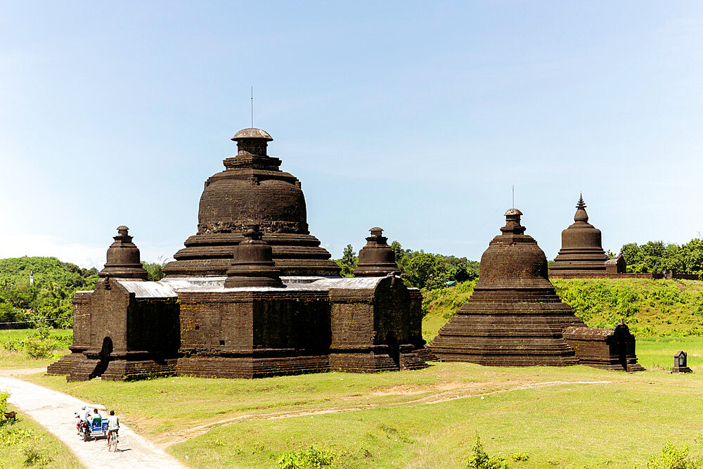 Lay Myet Hna Temple, with figures on a bicycle and motorbike on the road to the side, Mrauk U, Rakhine, Myanmar (Burma), Asia