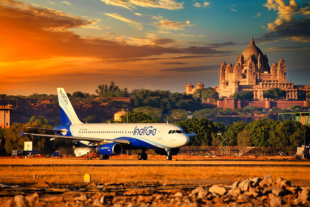 Indigo Airlines, Indian low cost carrier rolling out from Jodhpur Airport with the famous Umaid Bhawan Palace in background, Rajasthan, India, Asia