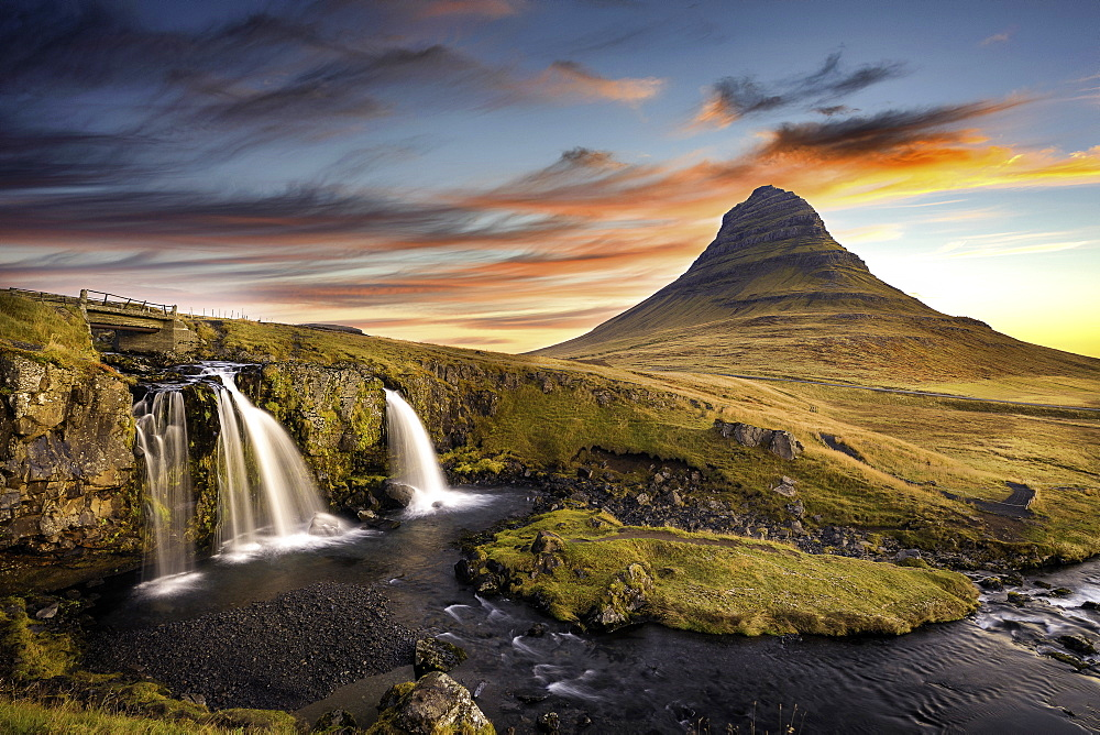 Sunrise at Kirkjufell Mountain overlooking a small waterfall, Iceland, Polar Regions